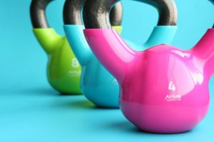 3 colourful kettle bells in a row
