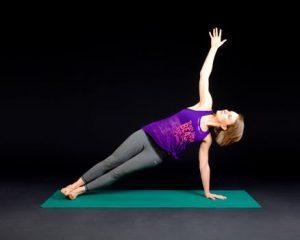 Woman doing yoga pose on a matt