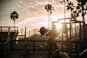 Man exercising with weights in an outdoor gym