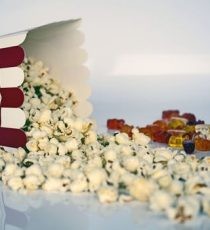 Popcorn in traditional tub poured on table at UK study