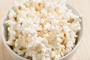 Low calorie popcorn in bowl in UK home